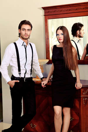 Portrait of a handsome fashionable man with  charming woman posing in the interior. Stock Photo - 10834954