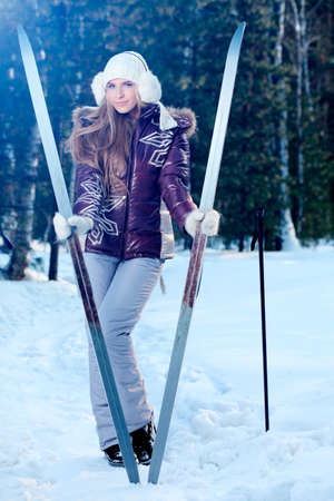 Pretty young woman having winter rest outdoor. photo