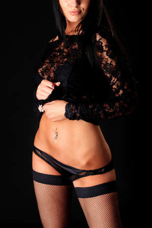 Shot of a sexy woman in black lingerie over black background. Stock Photo - 10871953