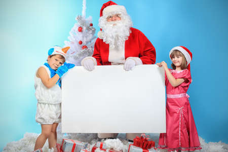 Christmas theme: Santa Claus and children having a fun.  photo