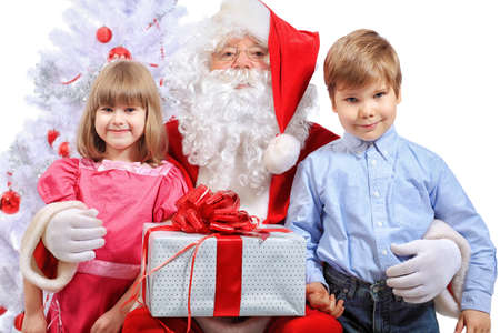 Christmas theme: Santa Claus and children having a fun. Isolated over white background. photo