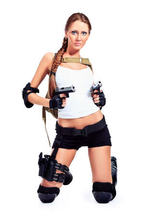 army girl: Shot of a sexy military woman posing with guns. Isolated over white.