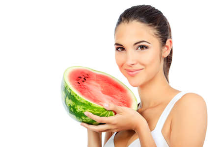 Portrait of a beautiful young woman with watermelon. Isolated over white background. Stock Photo - 10922689