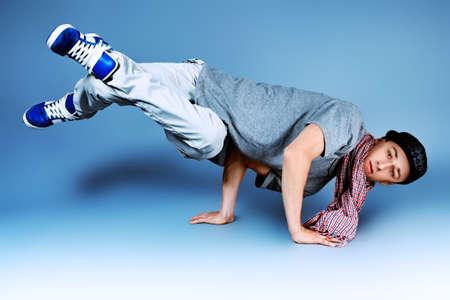 Young man dancing hip-hop at studio. photo