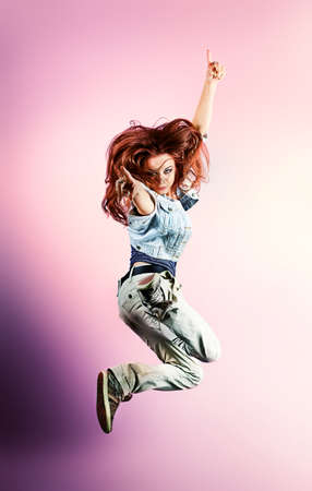 Teenage girl dancing hip-hop at studio. Stock Photo - 10922759