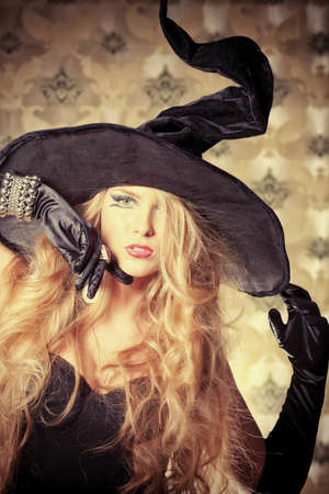 Charming halloween witch over vintage background. Stock Photo - 10922740