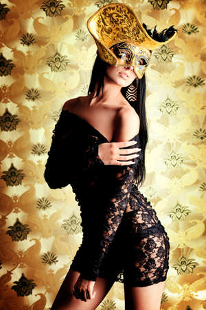 Shot of a sexy woman in erotic lingerie over vintage background. Stock Photo - 10922718