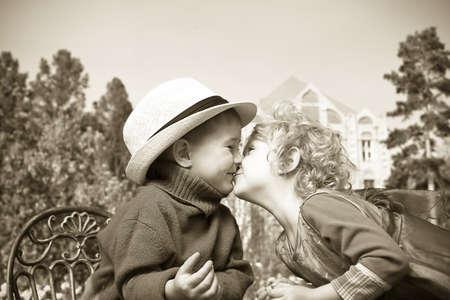 Romantic children at a park. Retro style. photo