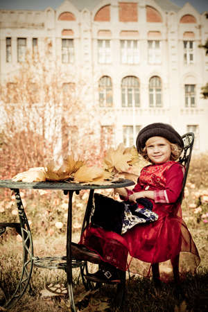 Cute little girl having a rest at a park. Retro style. Stock Photo - 10922722