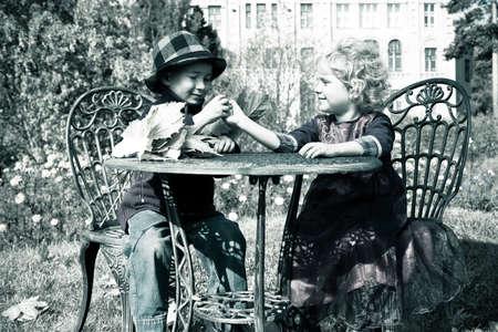 Cute children having a rest at a park. Retro style. photo