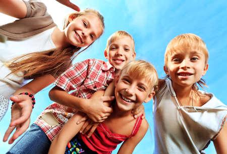 Group of happy children having fun outdoors. photo
