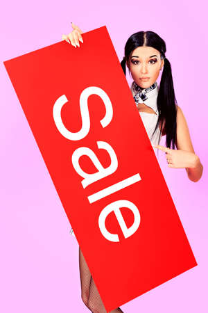Shot of an attractive young woman holding sale board. Stock Photo - 10930985