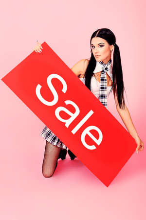 shopaholics: Shot of an attractive young woman holding sale board. Stock Photo