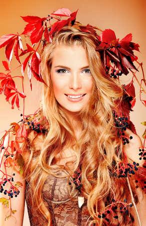 Portrait of a beautiful autumn woman with pumpkin. photo