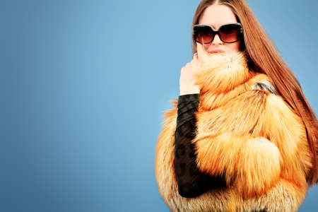 Portrait of a beautiful young woman in a fur. photo