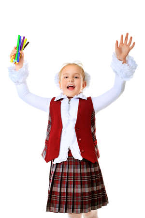 Portrait of an emotional schoolgirl. Isolated over white background. photo