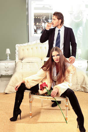 Portrait of a handsome fashionable man with  charming woman posing in the interior. Stock Photo