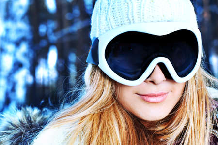 ski mask: Pretty young woman having winter rest outdoor. Stock Photo