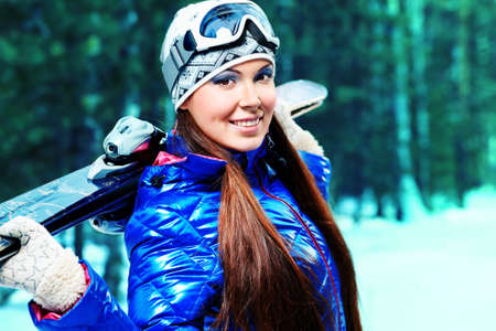 Sporty young woman posing with her skis outdoor. Stock Photo - 11044322