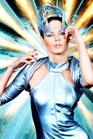 Fashion shot of a beautiful young woman in futuristic costume. photo