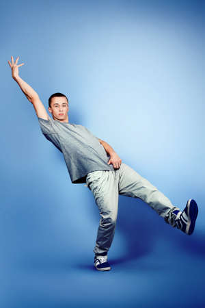 Young man dancing hip-hop at studio. Stock Photo
