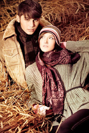 boyfriend: Portrait of a happy young couple in warm clothes outdoor.