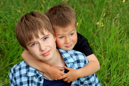Portrait of two happy boys brothers outdoors. photo