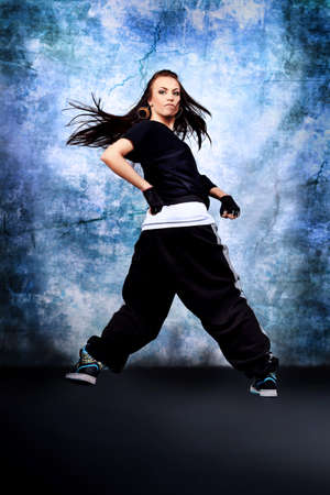 Modern teenage girl dancing hip-hop at studio. Stock Photo - 11185341