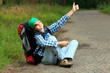 A boy teenager with knapsack posing outdoor. Tourism, active life. Stock Photo - 11185270