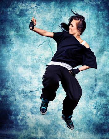 Modern teenage girl dancing hip-hop at studio. Stock Photo - 11185337