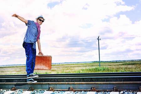 Handsome young man walking along railroad. Stock Photo - 11185090
