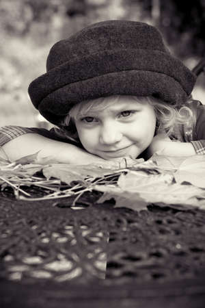 Cute little girl having a rest at a park. Retro style. Stock Photo - 11185093