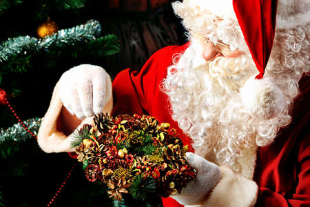 Santa Claus posing with presents over Christmas background. Stock Photo - 11185362