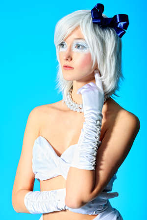 Portrait of an extravagant blonde model over blue background. Stock Photo - 11185199