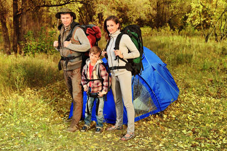 adventure holiday: Happy family having a rest outdoor in tent.