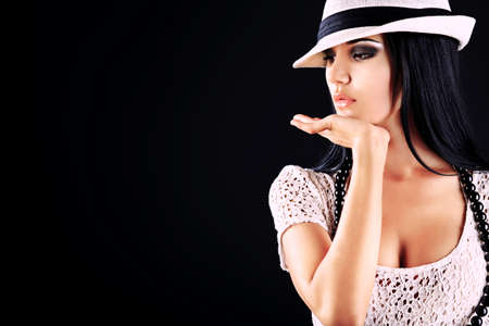 Fashion photo, a model is posing over black background Stock Photo - 11185223