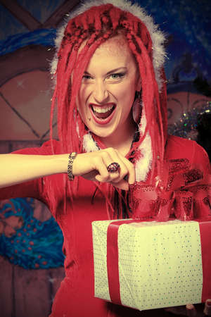Modern young woman in Santa Claus costume is celebrating Christmas. photo
