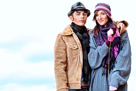 Portrait of a happy young couple in warm clothes outdoor. photo