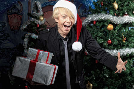 Portrait of a funny young man in Santa Claus hat. Christmas. photo