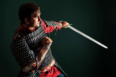 Portrait of a medieval male knight in armor over black background. Stock Photo - 11185155