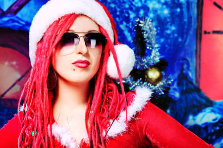 Modern young woman in Santa Claus costume is celebrating Christmas. Stock Photo - 11185129