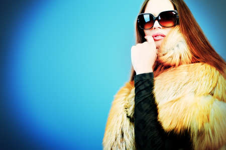 Portrait of a beautiful young woman in a fur. Stock Photo - 11261464