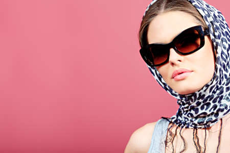 Portrait of an attractive young woman in sunglasses. Retro style. Stock Photo - 11261463