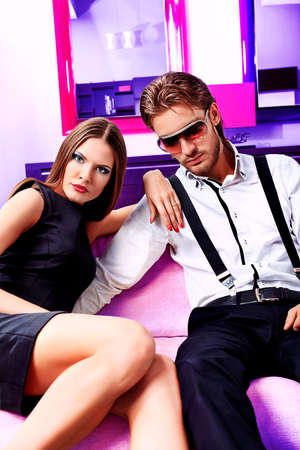 Portrait of a handsome fashionable man with  charming woman posing in the interior. Stock Photo - 11261502