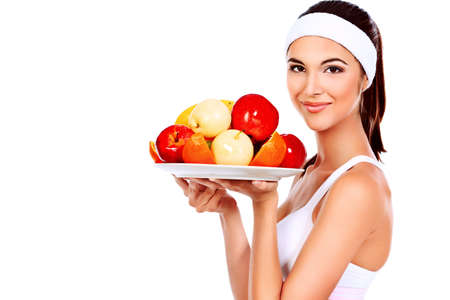 Portrait of a beautiful young woman with fruits. Isolated over white background. photo