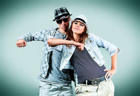 A couple of young man and woman dancing hip-hop at studio. Stock Photo - 11261544