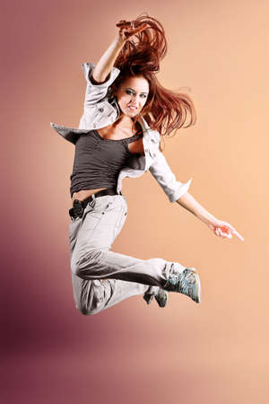 street dance: A couple of young man and woman dancing hip-hop at studio. Stock Photo