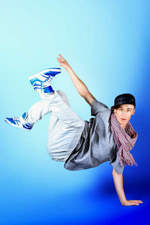 breakdance: Young man dancing hip-hop at studio. Stock Photo
