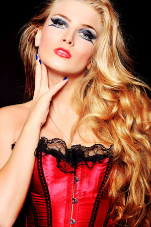 Portrait of a beautiful blonde woman over black background. photo