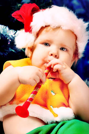 Beautiful child sitting with presents against Christmas background. Stock Photo - 11261595